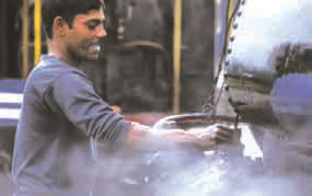 DHR staff examining steam locomotives