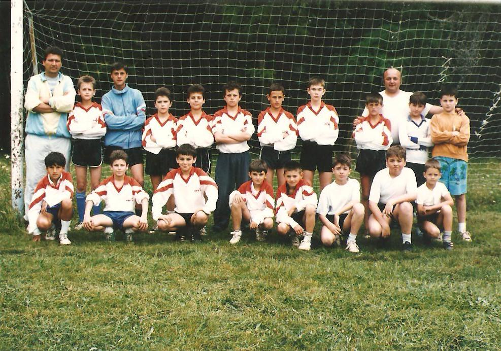 Local football team , juniors, the nineties (my brother in the front row , fourth from the right, my father in the last row from the right)