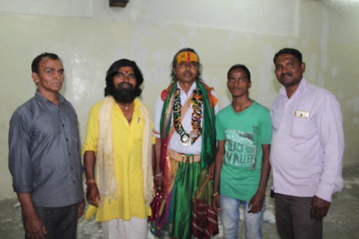 With well wishers and temple priest