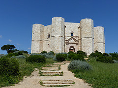 I visited this WHS in June 2014. I ventured on an early morning drive in the Alta Murgia National Park. The drive past rolling hills with red poppies, cherry trees and olive trees was already a good start but standing alone on a promontory  in the middle of the park was the Castel del Monte. There is a huge parking lot about 800 metres from it where I left my car and with the 5 euro ticket I got a return shuttle bus ride to the WHS. The castle is in a very good state and it really gleams in sunny weather. Its octagonal plan is really unique and several information boards inside the empty castle give you detailed info on the history, architecture and significance of this site. The courtyard is the main highlight inside the castle but other than that the 5 euro entrance fee doesn't offer much. The panoramic views from the castle are not to be missed and I think that opening the castle's terrace/roof in the future would make a much more interesting visit. I finished off my visit with a hearty snack near Andria - Focaccia bread with burratina ... bliss!