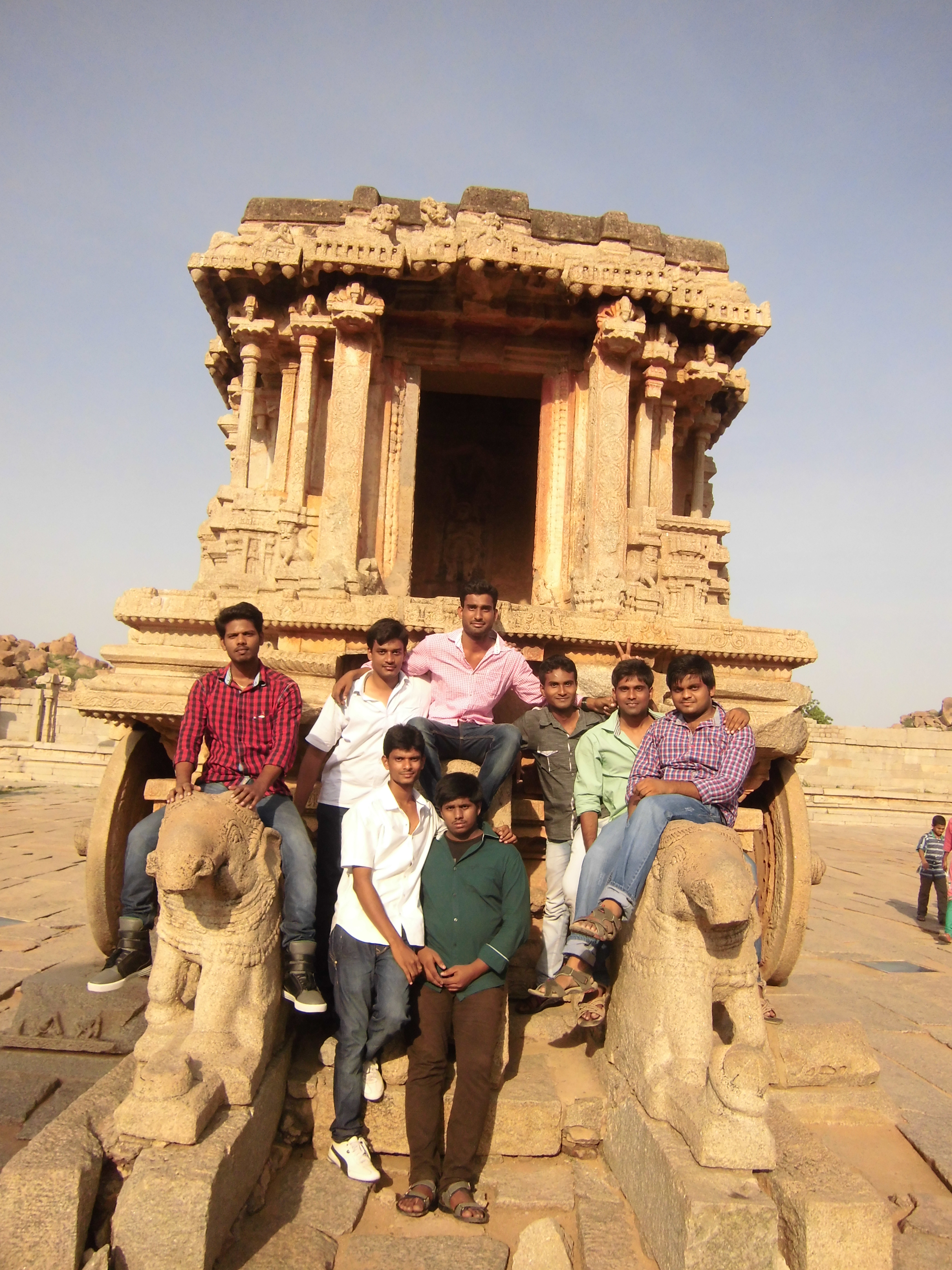 Hi everyone this is Umashankar(the red shirt guy in the photo). i'm from Tirupati, i went to hampi along with my friends in the month of June. we just graduated from the college so we want to celebrate it.at first many places came in to our minds. but i always love to visit Historical places so we searched on the web for a nearest site ,then Hampi came on to the picture. we started our journey from tirupati railway  station and it's a long way to reach hampi. we travelled 8hrs and stepped out from train at Hospet. we took a room near to station. and the next morning we began our adventure. first we saw Virupaksha temple and from there we roamed every corner of hampi in our two day trip. it's really a wonderful place to visit. especially the stone carving mantapas at vittala temple are just awesome. finally we returned after bagging undying memories of Hampi