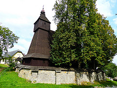 I visited this WHS in September 2014. This WHS is made up of 8 wooden churches in the Slovak Carpathians which bear a very strong resemblance to the Wooden Churches of Southern Malapolska and also some of the Wooden Tserkvas in Poland. The Slovak Wooden Churches seemed to combine some of the architectural elements from both these Polish WHS. Since I had visited quite a number of other non-inscribed Slovak wooden churches earlier and mostly because I had to drive back to Poland, I only had the chance to visit the wooden church of Hervartov. This Roman Catholic church is dedicated to St. Francis of Assisi and is said to be the most beautiful and representative of the 8 inscribed Slovak wooden churches. It also proudly houses the UNESCO WHS certificate. I had saved its coordinates on my GPS but they turned out to be the wrong coordinates. As with most of the wooden churches in Poland and Slovakia, they seem to be well hidden behind a number of trees so the best thing is to be on the lookout of tall trees and when in doubt just ask for help. Perhaps if you were to visit in Autumn or in Winter it would be easier to spot the wooden churches behind the leafless trees! When I arrived at the church's doorstep, a kind man opened the door and welcomed me in. He didn't speak English or German but he smilingly pointed to the UNESCO WHS certificate and the laminated information sheets available in different languages. Again the entrance fee of 2 euros + a camera fee of 3 euros wasn't cheap (perhaps I had got used to the idea of visiting the wooden churches and tserkvas for free in Poland!). At least I didn't have to knock around or phone for the keyholder to open the church as I had to do in Poland. The latin inscriptions as well as the beautiful frescoes of Adam and Eve and the Last Supper were the highlight of my visit. I hope to be able to visit some of the other inscribed churches near Bratislava in the future.