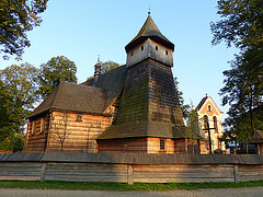 "I visited this WHS in September 2014. I visited 5 out of the 9 wooden churches of Southern Malapolska and managed to enter 4 of them to see the frescoes and paintings. I combined this WHS with the Wooden Tserkvas of Poland and I dedicated a full day driving from one wooden church/tserkva to the next. In a way they reminded me of a similar ""treasure hunt"" experience I had when visiting the churches in Val de Boi, Spain. I really enjoyed myself but I managed to visit so many churches only because I had done my homework beforehand. First of all I searched the churches/tserkvas on Google Maps to get an idea of their location. This helped me to decide on a logical order to visit the churches. Next, I entered their exact location (longitude/latitude) on my GPS which turned out to be a very wise idea as most of the wooden churches are well hidden behind tall trees and signs were non-existant. I got this information from http://whc.unesco.org/archive/2002/noms/1053.pdf. Then I wrote down Poland's telephone code (0048) as I knew I would be needing it to be able to call the church keyholders once I got there. The first wooden church I visited was the one in Lachowice which is quite similar to the other 2 churches I visited in Lipnica Murowana and Sekowa. The former church was closed and the keyholder was nowhere to be seen or reached by mobile phone. I was luckier with the other 2 churches and after calling the keyholder (their number is affixed on the church door), somebody turned up to open the church and switch on the lights. Most of the keyholders didn't speak English and only some of them spoke some German but they will gladly give you laminated information sheets inside. All the churches I visited were free although I had read that sometimes a small amount is charged to visit the church in Lipnica Murowana. These 3 churches are quite similar. They are built using the horizontal log technique (like all these inscribed churches), however their peculiarity lies in the steep roofs reaching close to the ground. The other 2 churches I visited didn't have this peculiarity and they had a different shape altogether. The church in Lipnica Murowana is the oldest inscribed wooden church and it houses the UNESCO WHS certificate inside. The interior wooden paintings are worth viewing and just behind the altarpiece there is a replica of the Pillar of Światowid, the only ""remains"" of an ancient pagan worship site on which this church was built. The original can be found in the Tarnów Diocese Museum. The church in Sekowa is the largest inscribed wooden church. The interior can be viewed through a barred iron gate or else just call the keyholder who will gladly open the door for a quick peek. The interior is not as interesting as the one in Lipnica Murowana. The next church I visited was the one in Binarowa (picture) and its peculiarity is the tower-like shape (similar to other inscribed wooden churches I didn't visit). The last church I visited is the one in Szalowa. It doesn't have any of the mentioned peculiarities and instead it has quite a conventional squarish architecture. There was mass going on when I visited so I couldn't spot anything of extraordinary interest inside. Most of these churches are too small for the present communities so some of them have rows of benches just in front of the main entrance so that everyone can be seated even if there isn't enough space inside the church. I wouldn't mind visiting the remaining inscribed wooden churches in the future although from what I read and saw, the most representative seems to be the one in Lipnica Murowana."