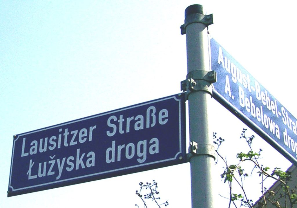 Cropped and brightened version of Cottbus zweisprachige Straßenbezeichnung.jpg, originally created by Blue.dragon on 2005-04-16.