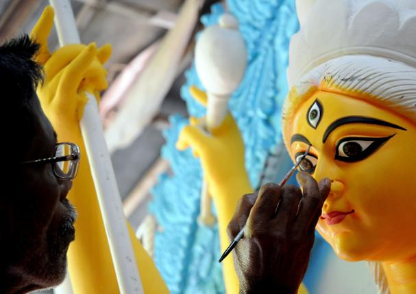 Goddess Durga's idol being painted by an artisan in Kumartuli Picture Courtesy: The Hindu
