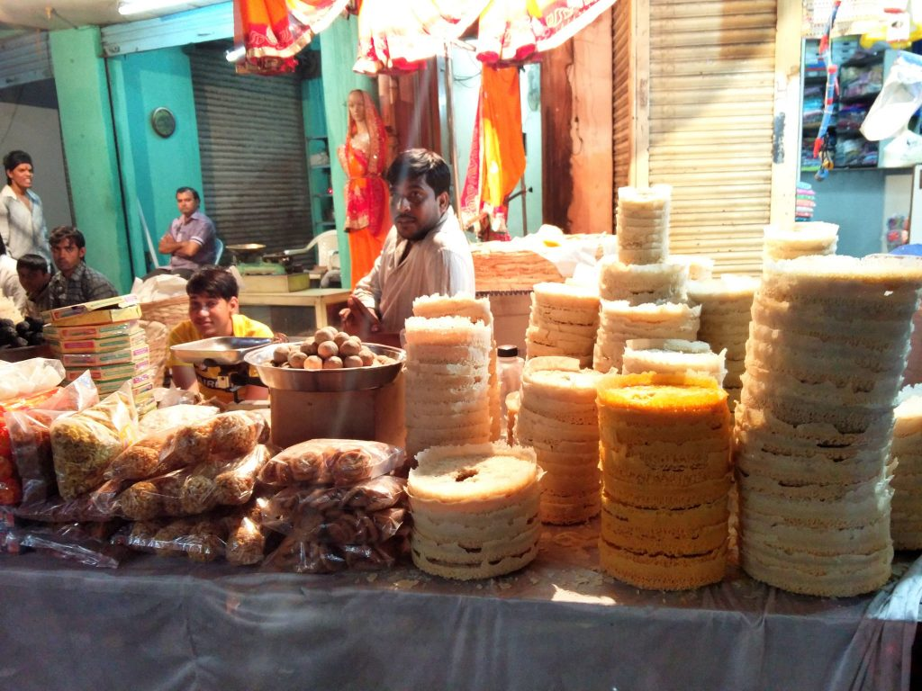 Stacks of freshly-made ghevar are ready to be sold in Hyderabad. Photo credit: Food Drifter/Flickr
