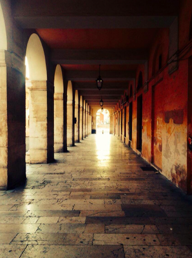 Colonnades and arcades of the Ercolani Porticos at sunset. Picture taken by the author