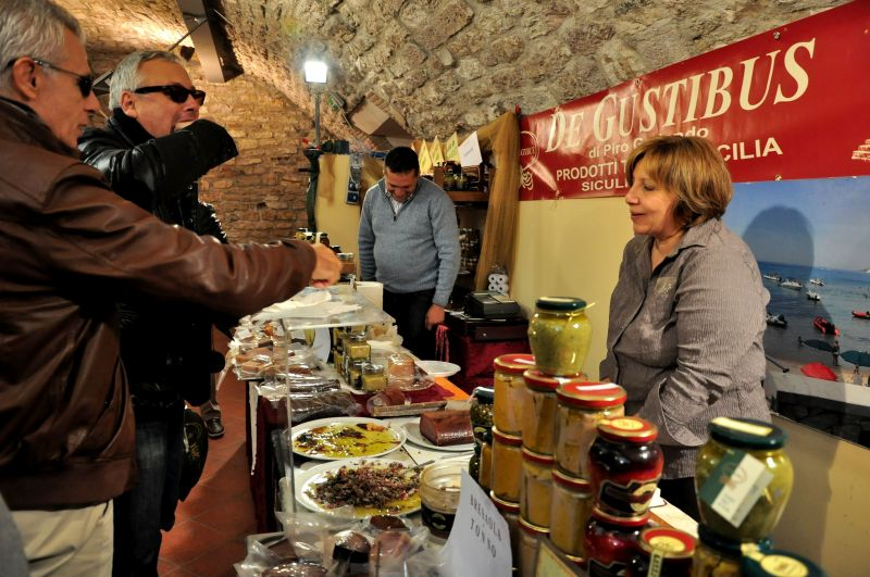 Tasting Sicilian specialties at the Gubbio festival. Photo credit: walksofitaly.com