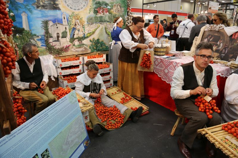 Tomato growers at a food festival in Italy. Photo credit: ourpacificways.wordpress.com