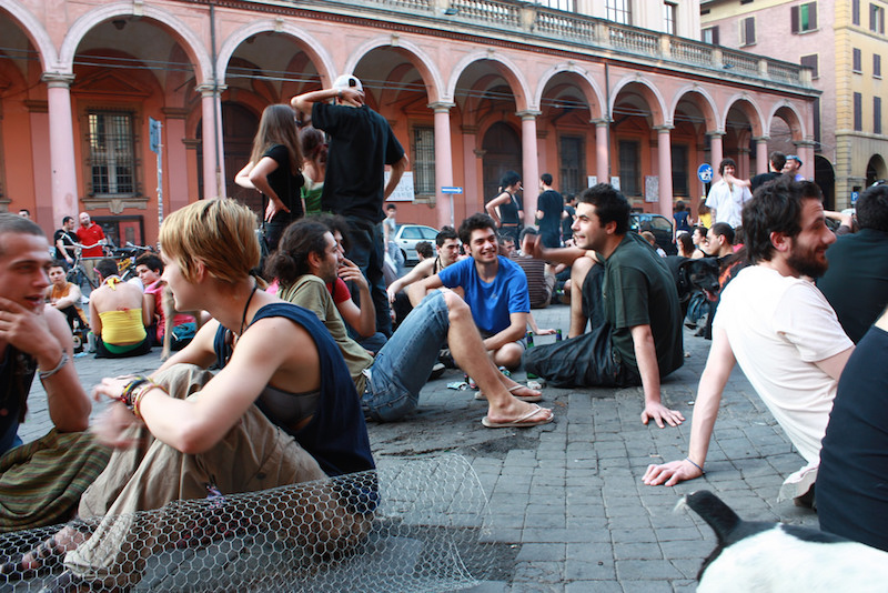 Young people chilling in front of the porticoes at Piazza Verdi. Photo credit: Flickr